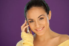 Smiling brunette chatting on her mobile Stock Photo