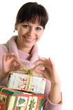 Smiling brunette with Christmas presents. Young brunette with Christmas presents isolated over white Royalty Free Stock Images