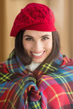 Smiling brunette with cover and red hat Stock Images