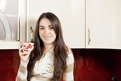 Smiling brunette with cup Royalty Free Stock Photos