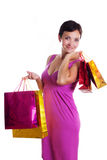 Smiling brunette in dress with shopping bags Stock Photography