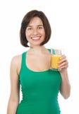 Smiling brunette drinking an orange juice Stock Image