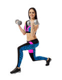 Smiling brunette exercising with dumbbells Stock Photos
