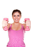 Smiling brunette  exercising with weights Royalty Free Stock Images