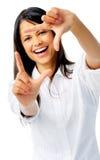 Smiling brunette framing her face Stock Photo