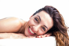 Smiling brunette getting hot stone massage Royalty Free Stock Photography