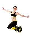 Smiling brunette girl  jumping in a kangoo jumps shoes. Stock Image