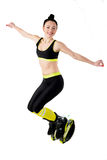 Smiling brunette girl  jumping in a kangoo jumps shoes. Royalty Free Stock Image