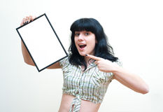Smiling brunette girl pin up dress showing blank frame on white Royalty Free Stock Photo