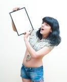Smiling brunette girl pin up dress showing blank frame on white Stock Images
