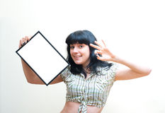 Smiling brunette girl pin up dress showing blank frame on white Stock Photos