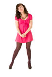Smiling brunette girl in pink dress posing Stock Photos