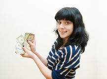 Smiling brunette girl showing money in hands Stock Images