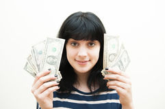 Smiling brunette girl showing money in hands Royalty Free Stock Images