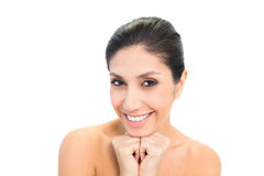Smiling brunette with hands together under her chin Stock Image