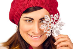 Smiling brunette in hat holding snowflake Royalty Free Stock Photos