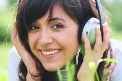 Smiling brunette with headphones Royalty Free Stock Images