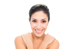 Smiling brunette with her hands on shoulders Stock Photography