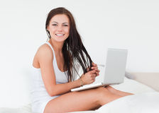 Smiling brunette with her laptop Stock Photo
