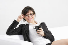 Smiling brunette holding cup Royalty Free Stock Images