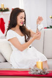 Smiling brunette holding heart for decoration Royalty Free Stock Photo