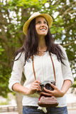 Smiling brunette holding old fashioned camera Royalty Free Stock Photo