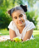 Smiling brunette little girl in summer day Stock Image