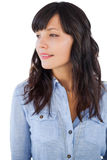 Smiling brunette looking away Stock Photos