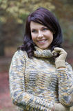 Smiling brunette in park Stock Photography
