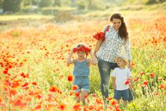 Young mother with her children Stock Photos