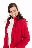 Smiling brunette posing with winter wear Royalty Free Stock Photography