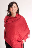 Smiling brunette in a red shawl Stock Photo