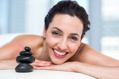 Smiling brunette relaxing on massage table Royalty Free Stock Images