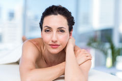 Smiling brunette relaxing on massage table Royalty Free Stock Photo