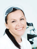 Smiling brunette researcher in laboratory Royalty Free Stock Photography