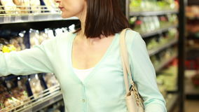 Smiling brunette shopping with grocery list stock video
