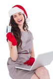 Smiling brunette shopping online with laptop Royalty Free Stock Photography