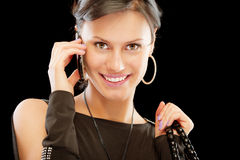 Smiling brunette speaks by mobile phone Stock Image