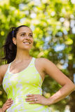 Smiling brunette in sportswear with her hands on hips Royalty Free Stock Image