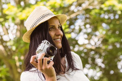 Smiling brunette in straw hat holding retro camera Royalty Free Stock Photo