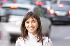 Smiling brunette and traffic Royalty Free Stock Photos