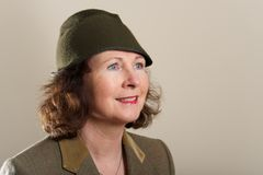 Smiling brunette in tweed jacket and hat Stock Photos