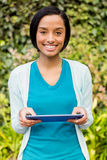 Smiling brunette using tablet Royalty Free Stock Photography