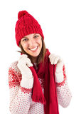 Smiling brunette in warm clothing looking at camera Royalty Free Stock Photos