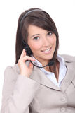 Smiling brunette wearing a headset Royalty Free Stock Image