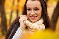 Smiling brunette woman in autumn park Royalty Free Stock Photos