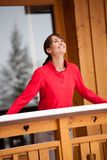 Smiling Woman on a balcony in winter. Smiling and brunette Woman on a balcony in winter stock images