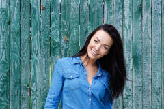 Smiling brunette woman with blue shirt Royalty Free Stock Images