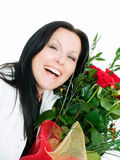 Smiling brunette woman with bouquet of flowers Royalty Free Stock Photo