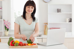 Smiling brunette woman cooking Stock Photo
